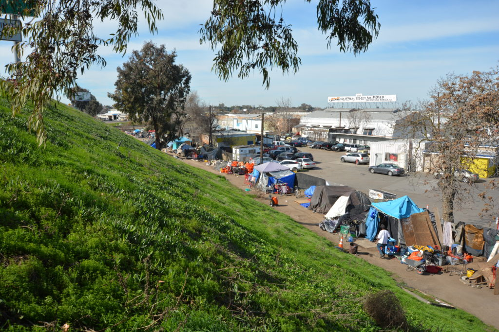 Homeless camp along Highway 99 near Bystrom