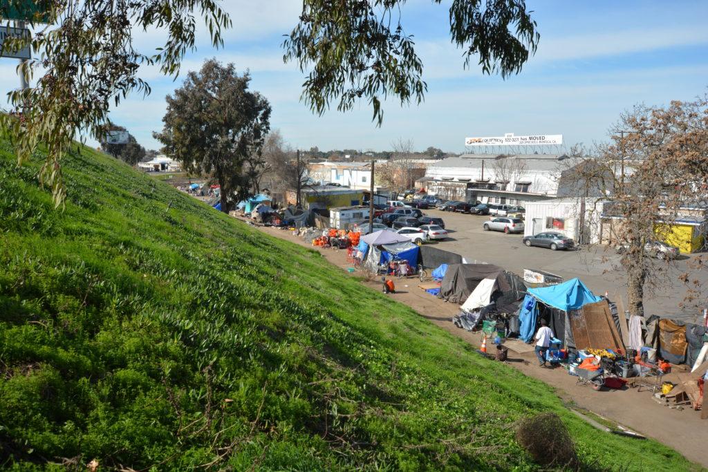 Homeless camp along Highway 99 near Bystrom