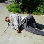 Man on sidewalk near 7th Street Modesto2021